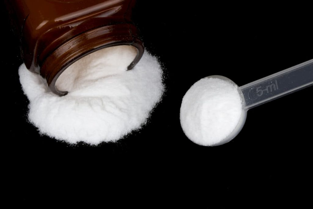 Creatine monohydrate powder isolated on black background - Carnivore Diet: The Creatine Phosphate Energy System